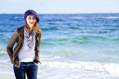 Fashion young women at the beach in sunny day. — Стоковое фото