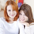 Portrait of two girlfriends indoor. — Stock Photo