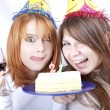 Two girlfriends with cake and wine celebrate 21th birthday — Stock Photo