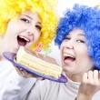 Two girlfriends with cake and wig celebrate 21th birthday — Stock Photo #3996902