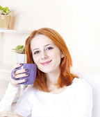 Portrait of red-haired girl with violet cup. — Stock Photo