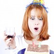 Red-haired with wine glass and cake celebrate her 21th birthday. — Stock Photo