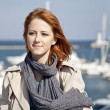 Portrait of fashion girl at port near yachts. — Stock Photo