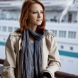 Portrait of fashion girl at port near boat. — Stock Photo