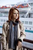 Portrait of fashion girl at port near boat. — Stock Photo