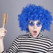 Surprised blue hair girl with comb. — Stock Photo