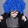 Funny blue-hair girl in glasses and black coat. — Stock Photo #4080841