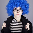 Funny blue-hair girl in glasses and black coat. — Stock Photo