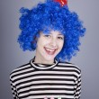 Funny blue-hair girl with cake. — Stock Photo