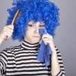 Portrait of sad girl with blue hair and comb. — Stock Photo