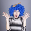 Surprised blue hair girl with stuck comb. — Stock Photo