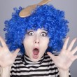 Surprised blue hair girl with stuck comb. — Stock Photo #4081239