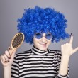 Coquette blue-hair girl with comb. — Stock Photo
