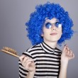 Stock Photo: Coquette blue-hair girl with comb.