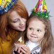 Two sisters four and eighteen years old at birthday. - Stock Photo