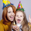Stock Photo: Two sisters four and eighteen years old at birthday.