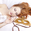 Sleeping woman near carnival mask. — Stock Photo