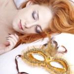 Sleeping woman near carnival mask. — Stock Photo #4081492
