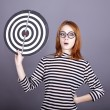 Red-haired girl with dartboard. — Stock Photo #4081515