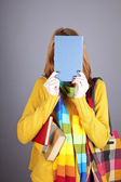 Student girl with blue book near head. — Stockfoto