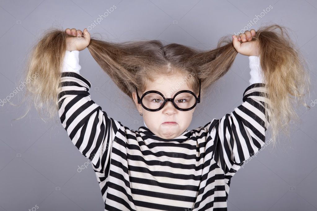 Young shouting child in glasses and striped knitted jacket. Studio shot.  — Stock Photo #4081320