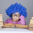Young blue-haired girl with books. — Stockfoto
