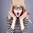 Surprise girl in winter cap and glasses. — Stock Photo