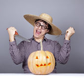 Funny men try to eat a pumpkin. — Stock Photo