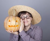 Funny men showing a pumpkin. — Stock Photo