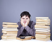 The young student with the books and headphone isolated. — Stock Photo