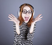 Funny girl with headphone and glasses. — Stock Photo