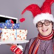 Funny men in christmas cap with gift boxes and notebook. — Stock Photo