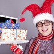 Funny men in christmas cap with gift boxes and notebook. — Stock Photo #4315417