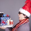 Funny men in christmas cap with gift boxes and notebook. — Stock Photo #4315425