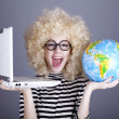Funny girl in glasses keeping notebook and globe. — Stock Photo