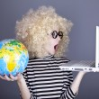 Funny girl in glasses keeping notebook and globe. — 图库照片
