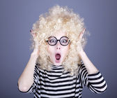 Portrait of feared girl in blonde wig. — Stock Photo