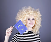 Beautiful girl with ringlets show European Union flag. — Stock Photo