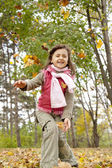 Cute girl in autumn park. — Stock Photo