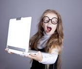 Young little girl in glasses with notebook. — Stock Photo