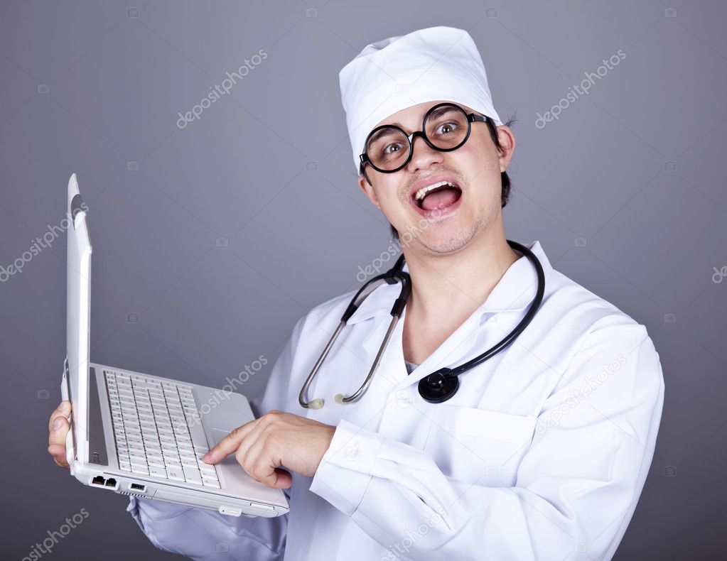 Shouting doctor with notebook. Studio shot.  — Stock Photo #4337041