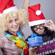 Two funny girls with christmas gifts. — Stock Photo #4356693