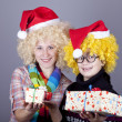 Two funny girls with christmas gifts. — Stock Photo #4356721
