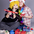 Two funny girls with christmas gifts. — Stock Photo #4356763