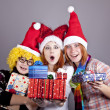 Three girlfriends in funny hats with christmas gifts. — Stock Photo #4356795