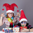 Two funny girls with christmas gifts. — Stock Photo