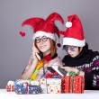 Two girls calling to Santa for better christmas gift. - Стоковая фотография