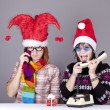 Two girls calling to Santa for better christmas gift. — Stock Photo