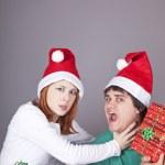 Girl strangling her boyfriend for a christmas gift. — Stock Photo #4356873