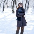 Beautiful young red-haired woman in winter park — Stock Photo #4809577
